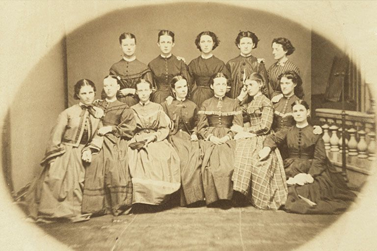 Formal portrait of first female IU students