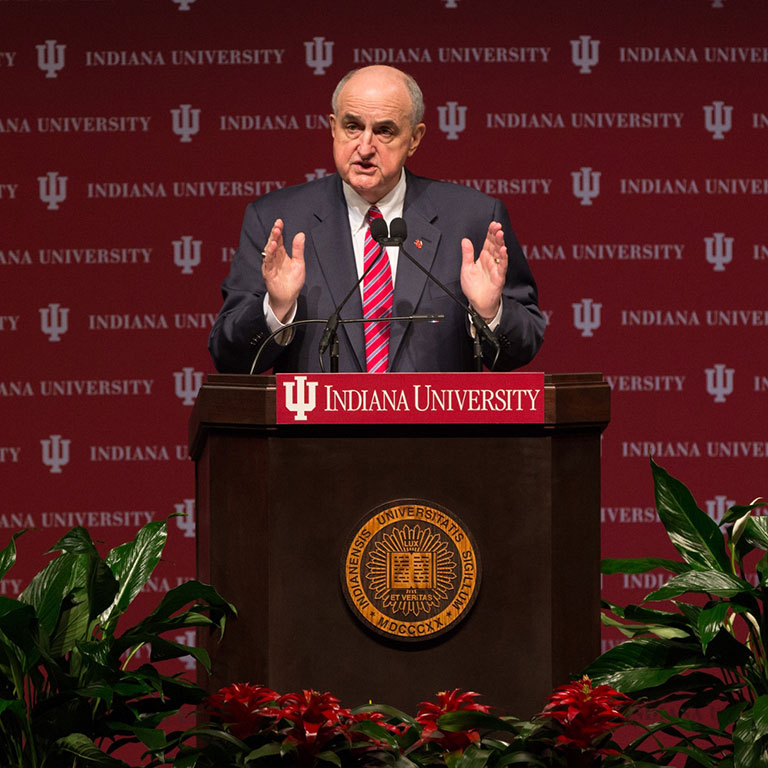 President McRobbie speaks at a podium during the State of the University address.