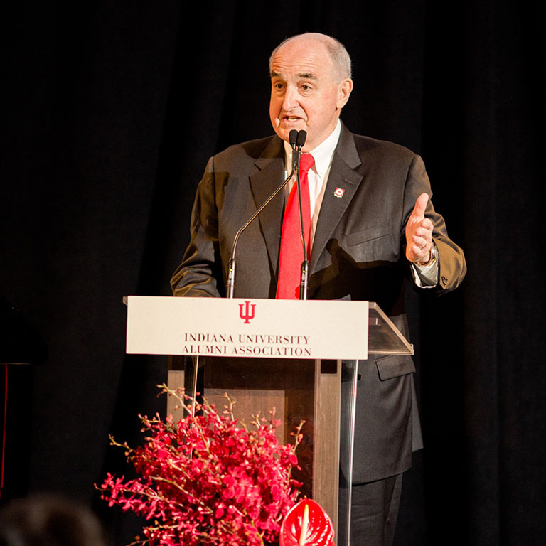 President McRobbie speaks at a podium