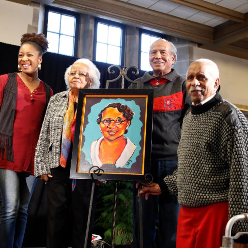 carrie parker portrait with carrie's family beside it